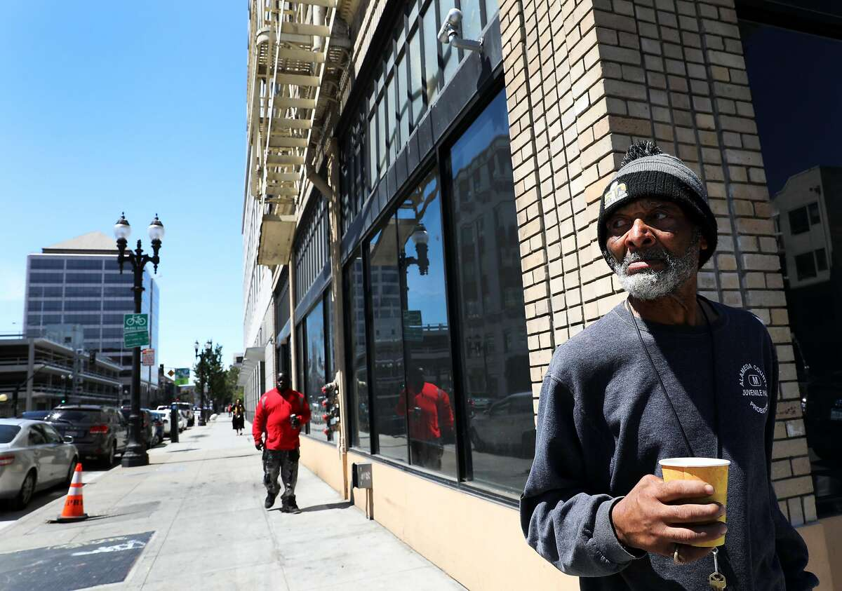 Rufus Boykin (name and age he provided to me), 70, stands outside the Henry Robinson Center, a transitional housing facility, in downtown Oakland, Cali. on Wednesday, July 18, 2018.