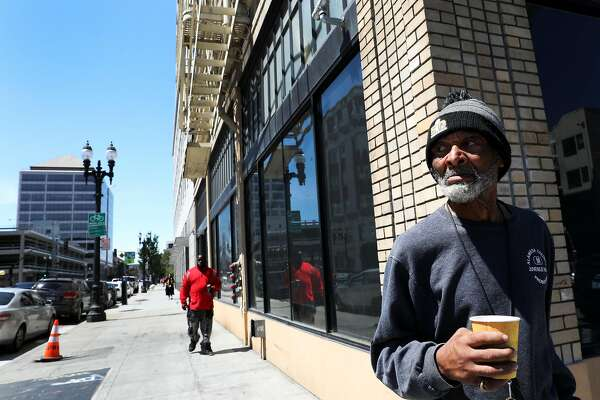 """Rufus Boykin (name and age he provided to me), 70, stands outside the Henry Robinson Center, a transitional housing facility, in downtown Oakland, Cali. on Wednesday, July 18, 2018. """"I want to work my way back into society,"""" said Boykin, who once lived on the streets. """"I have power - I just have to figure out how to use it."""""""