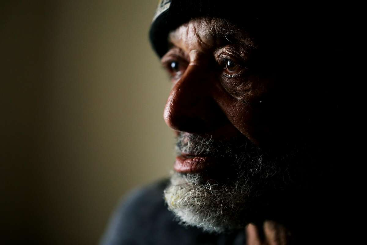 Rufus Boykin (name and age he provided to me), 70, sits in his bedroom at the Henry Robinson Center, a transitional housing facility, as he poses for a portrait in downtown Oakland, Cali. on Wednesday, July 18, 2018.
