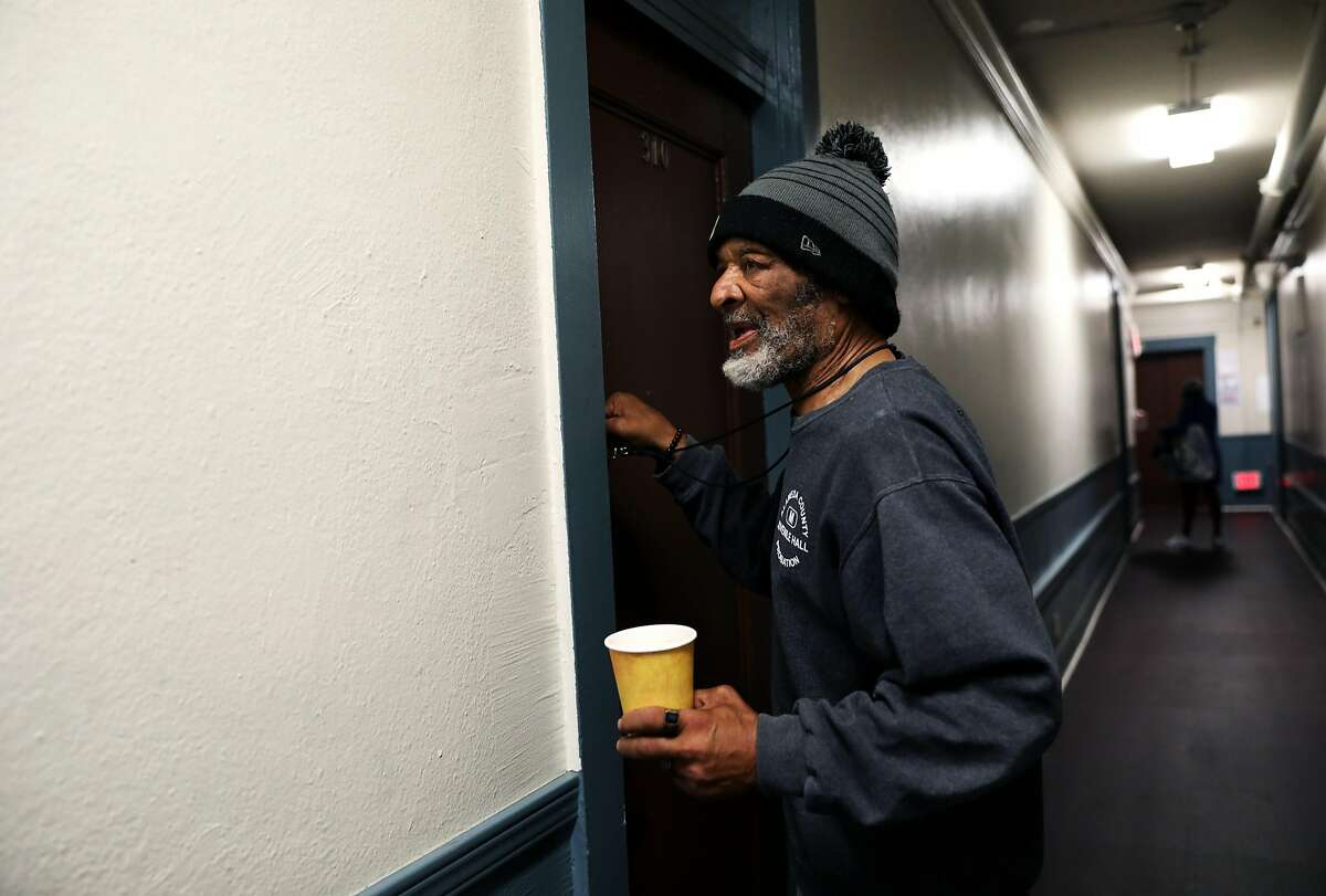 Rufus Boykin (name and age he provided to me), 70, locks his door as he leaves his room at the Henry Robinson Center, a transitional housing facility, in downtown Oakland, Cali. on Wednesday, July 18, 2018.