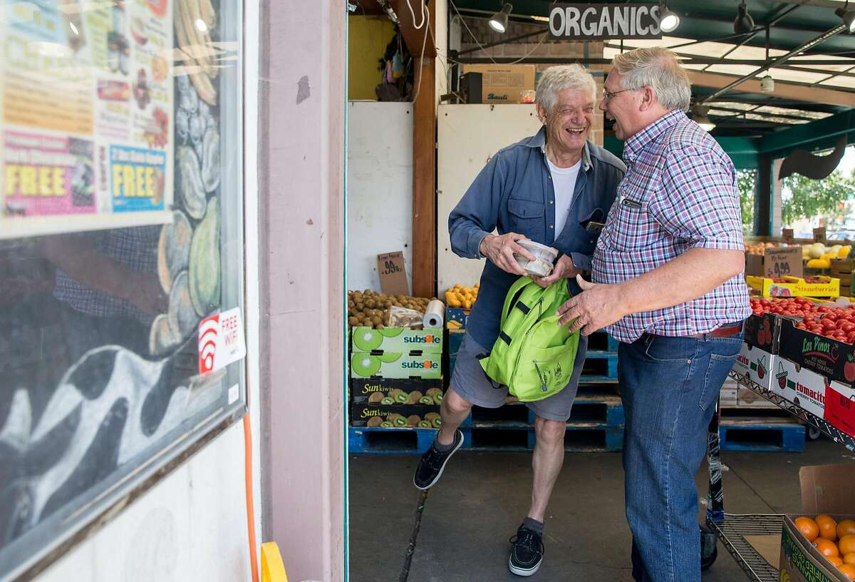 Milk Pail Market owner Steve Rasmussen, right, stops to chat with a customer who gave his name as Hartmut while he shops for groceries in Mountain View, Calif. Wednesday, July 18, 2018.