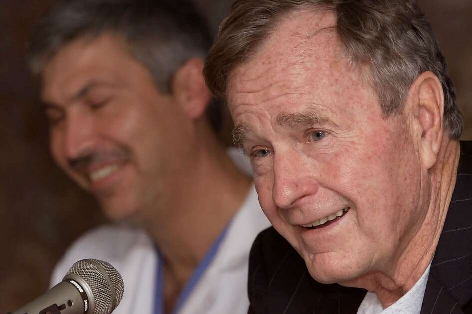 Former President George Bush, right, answers questions about his heart condition as cardiologist Mark Hausknecht laughs during a news conference at Methodist Hospital on Friday, Feb. 25, 2000 in Houston. Bush spent Thursday night in a Florida hospital and was released Friday after being treated for an irregular heartbeat. Doctors will investigate whether Bush's thyroid disorder, called Graves' disease, caused the irregularity. It was responsible for a similar episode he suffered while jogging in May 1991. (AP Photo/David J. Phillip)