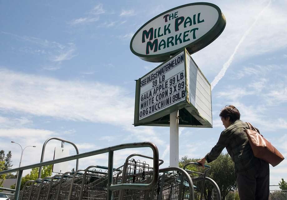 A woman retrieves a cart before shopping for groceries at Milk Pail Market in Mountain View, Calif. Wednesday, July 18, 2018. Photo: Jessica Christian / The Chronicle