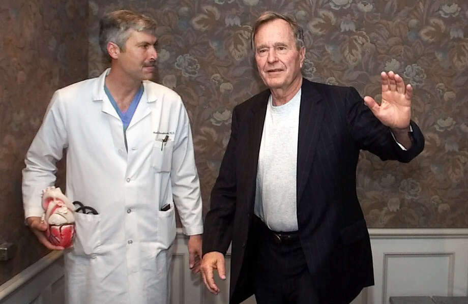 FILE - This photo from 2000 shows cardiologist Mark Hausknecht, left, who once treated former President George H.W. Bush, was shot and killed while riding a bicycle in Houston. Photo: DAVID J. PHILLIP/Associated Press