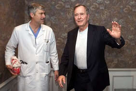 FILE - This photo from 2000 shows cardiologist Mark Hausknecht, left, who once treated former President George H.W. Bush, was shot and killed while riding a bicycle in Houston.