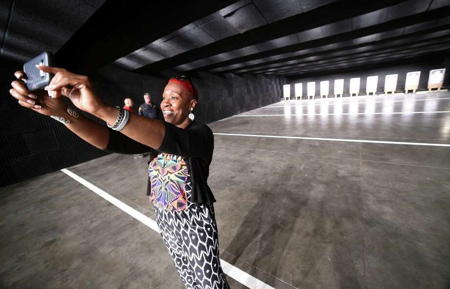 State Rep. Robyn Porter takes a selfie inside the New Haven Police Department's new indoor firing and training center on Wintergreen Ave. in New Haven Friday. Photo: Arnold Gold / Hearst Connecticut Media / New Haven Register
