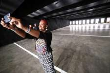 State Rep. Robyn Porter takes a selfie inside the New Haven Police Department's new indoor firing and training center on Wintergreen Ave. in New Haven Friday.
