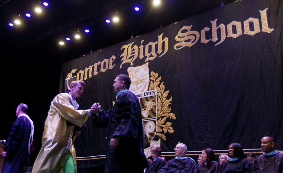 Principal Mark Weatherly, right, greets Blaine Alger during a Conroe High School graduation ceremony at Cynthia Woods Mitchell Pavilion, Tuesday, May 30, 2017, in The Woodlands. Photo: Jason Fochtman, Staff Photographer / Houston Chronicle / © 2017 Houston Chronicle