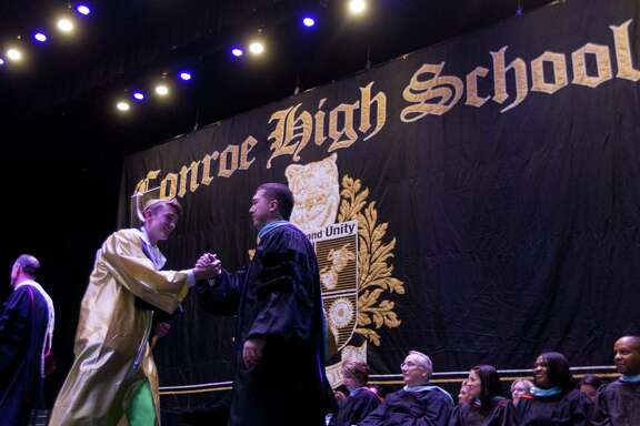 Principal Mark Weatherly, right, greets Blaine Alger during a Conroe High School graduation ceremony at Cynthia Woods Mitchell Pavilion, Tuesday, May 30, 2017, in The Woodlands.