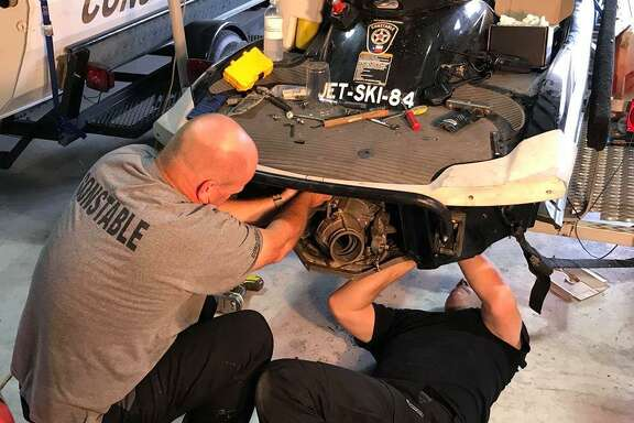 """Constable Kenneth """"Rowdy"""" Hayden assists recently installed a new thick walled impeller to help with some of the debris that may be in the water and also replaced the spark plugs, oil and gas to ensure they are prepared for any natural weather disaster."""