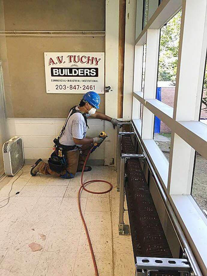 Alvaro Ramirez, an apprentice carpenter employed by A.V. Tuchy Builders of Norwalk, works on window-replacement project at West Rocks School. Ramirez landed his job through an apprenticeship program set up by SoNo Collection builder General Growth Properties and Carpenters Local 326. Photo: Contributed Photo / Contributed Photo / Norwalk Hour contributed