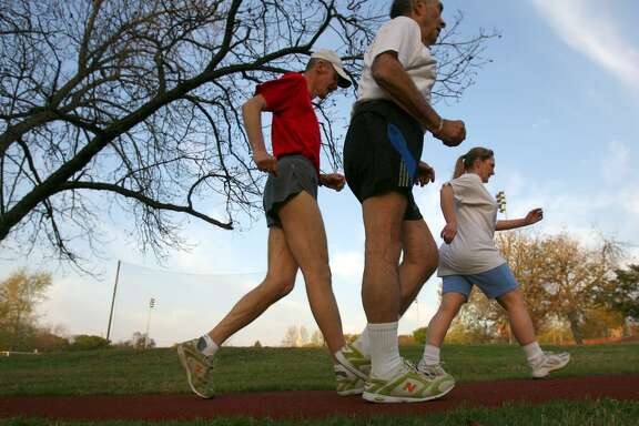 Slow walkers can graduate to racewalkers such as Victoria Cruz, front, Leonard Stern, center, and Bert Pickell, seen here walking briskly on the trail going around the soccer field at Trinity University in 2008.
