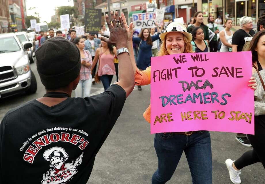 Allison Banks of Berkeley high fives a man as a protest march heads down Durant Avenue during pro-DACA rally in Berkeley, Calif., on Sept. 5. A reader says the public is forgetting the Dreamers. Photo: Scott Strazzante /The Chronicle / San Francisco Chronicle