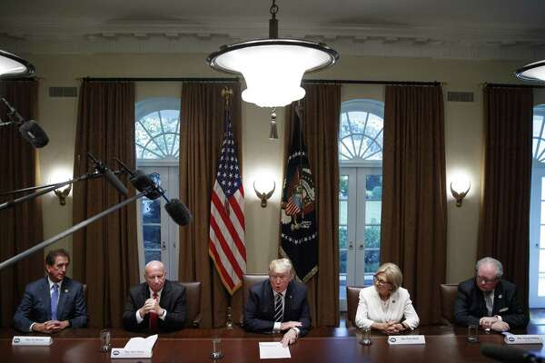 President Donald Trump delivers remarks with members of Congress on Tuesday inside the Roosevelt Room of The White House. Trump said Wednesday via Twitter that many people at the higher ends of intelligence loved his performance during Mondays joint news conference in Finland, with President Vladimir Putin of Russia.