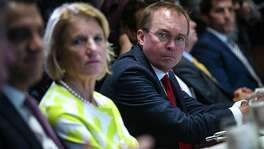 Mick Mulvaney, director of the Office of Management and Budget (OMB), right, shown here June 26, has proposed a merger of the labor and education departments.