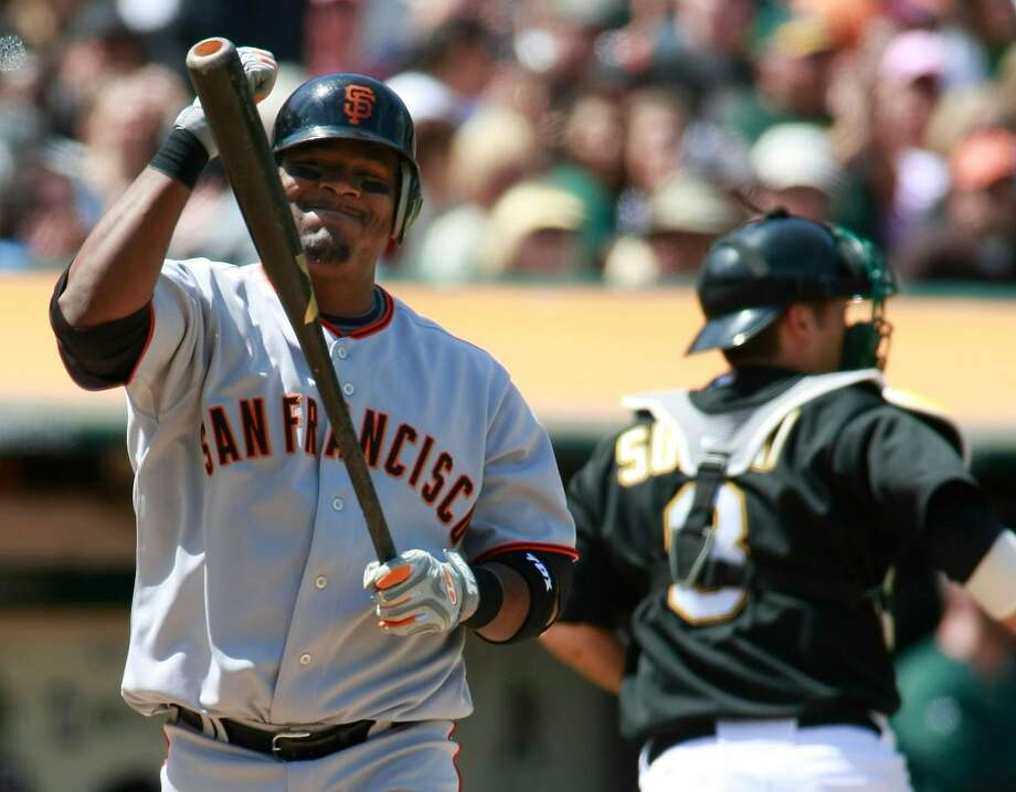 Giants third baseman Juan Uribe strikes out in at the Oakland Coliseum in a May, 2010 interleague game. The Giants lost that game 1-0 and were swept in the series, but things worked out in the end when they won the World Series. Photo: Darryl Bush / AP