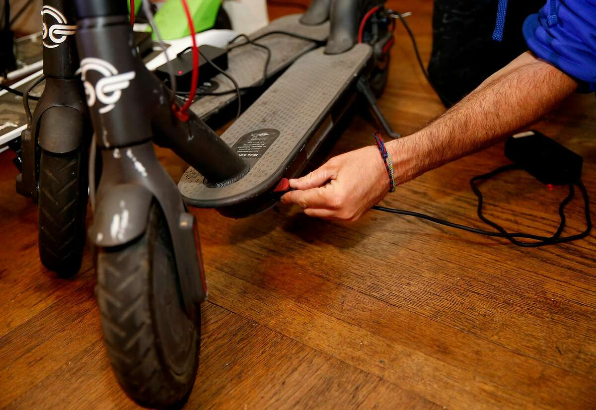 David Padover, who is a Juicer for Lime-S and Bird, connects scooter to chargers at his home in San Jose, California on July16, 2018. (Josie Lepe/Special to the Chronicle)