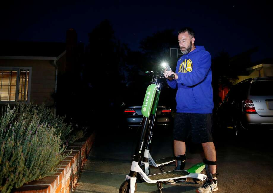 David Padover, picks up a Lime-S scooter in the Rose Garden neighborhood in San Jose. Photo: Josie Lepe / Special To The Chronicle