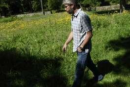 Greenwich Land Trust Executive Director Will Kies walks through the meadow section of the new accessible walking trail at the Greenwich Land Trust Mueller Preserve in Greenwich, Conn. Thursday, July 19, 2018. The new trail traverses four acres of land showing a variety of different habitats and ecosystems, a microcosm of those found throughout the town, over the short loop.