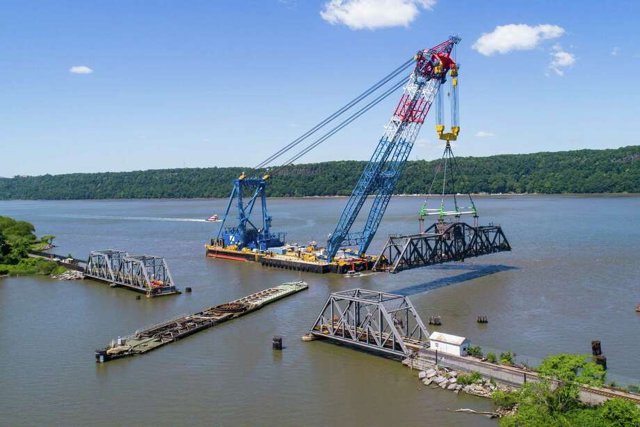 The Left Coast Lifter moves the Spuyten Duyvil rail bridge to a barge, where workers will repair its mechanical and electrical systems. The crane was also used on construction of the new Tappan Zee Bridge. Photo: Photo Provided By Amtrak