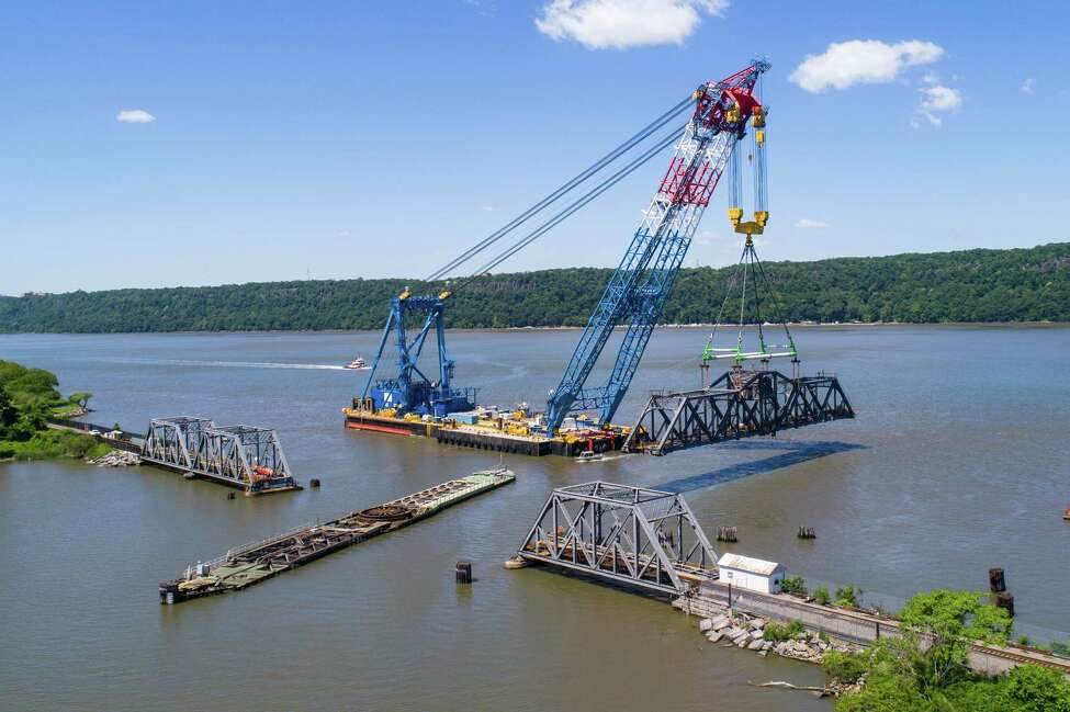 The Left Coast Lifter moves the Spuyten Duyvil rail bridge to a barge, where workers will repair its mechanical and electrical systems. The crane was also used on construction of the new Tappan Zee Bridge.