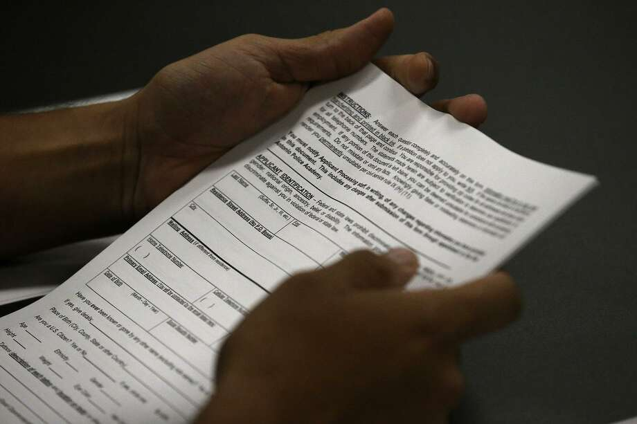 An applicant to the San Antonio Police Department's training academy holds paperwork Tuesday August 15, 2017 during a workshop about the application process. The statewide unemployment rate for June was 4 percent, the same as the overall U.S. rate, according to the Bureau of Labor Statistics. The Texas unemployment rate in May was 4.1 percent. Photo: John Davenport /San Antonio Express-News / ©John Davenport/San Antonio Express-News