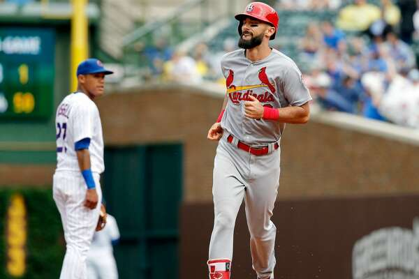 CHICAGO, IL - JULY 20: Matt Carpenter #13 of the St. Louis Cardinals rounds the bases after hitting a three run home run as Addison Russell #27 of the Chicago Cubs looks on during the sixth inning at Wrigley Field on July 20, 2018 in Chicago, Illinois. This was the third home run for Matt Carpenter of the game. (Photo by Jon Durr/Getty Images)