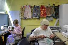 Carmela Billingham, left, and Leila Hiteshew are part of a  group of Bethel seniors who gather at the Senior Center every Wednesday to sew clothes for children in need.  Photo Wednesday, July 11, 2018.