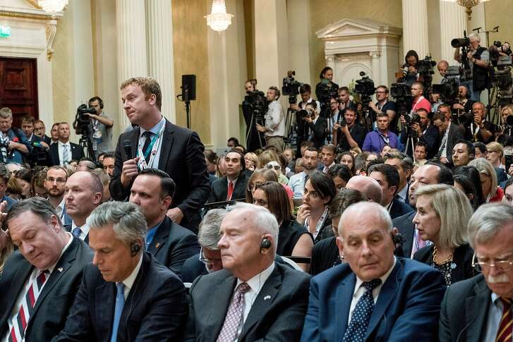 Jonathan Lemire, a reporter with The Associated Press, asks questions of President Donald Trump and President Vladimir Putin of Russia during a joint news conference at the Presidential Palace in Helsinki, Finland, July 16, 2018. Lemire asked President Vladimir V. Putin of Russia if he had compromising material on President Trump. Putin called it �nonsense.� (Doug Mills/The New York Times)