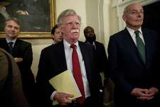 National security adviser John Bolton, center, and President Donald Trump's chief of staff John Kelly, right, attend a meeting with President Donald Trump and members of Congress in the Cabinet Room of the White House, Tuesday, July 17, 2018, in Washington. Trump in his remarks says 'I accept' US intelligence agencies conclusions on Russian meddling. (AP Photo/Andrew Harnik)