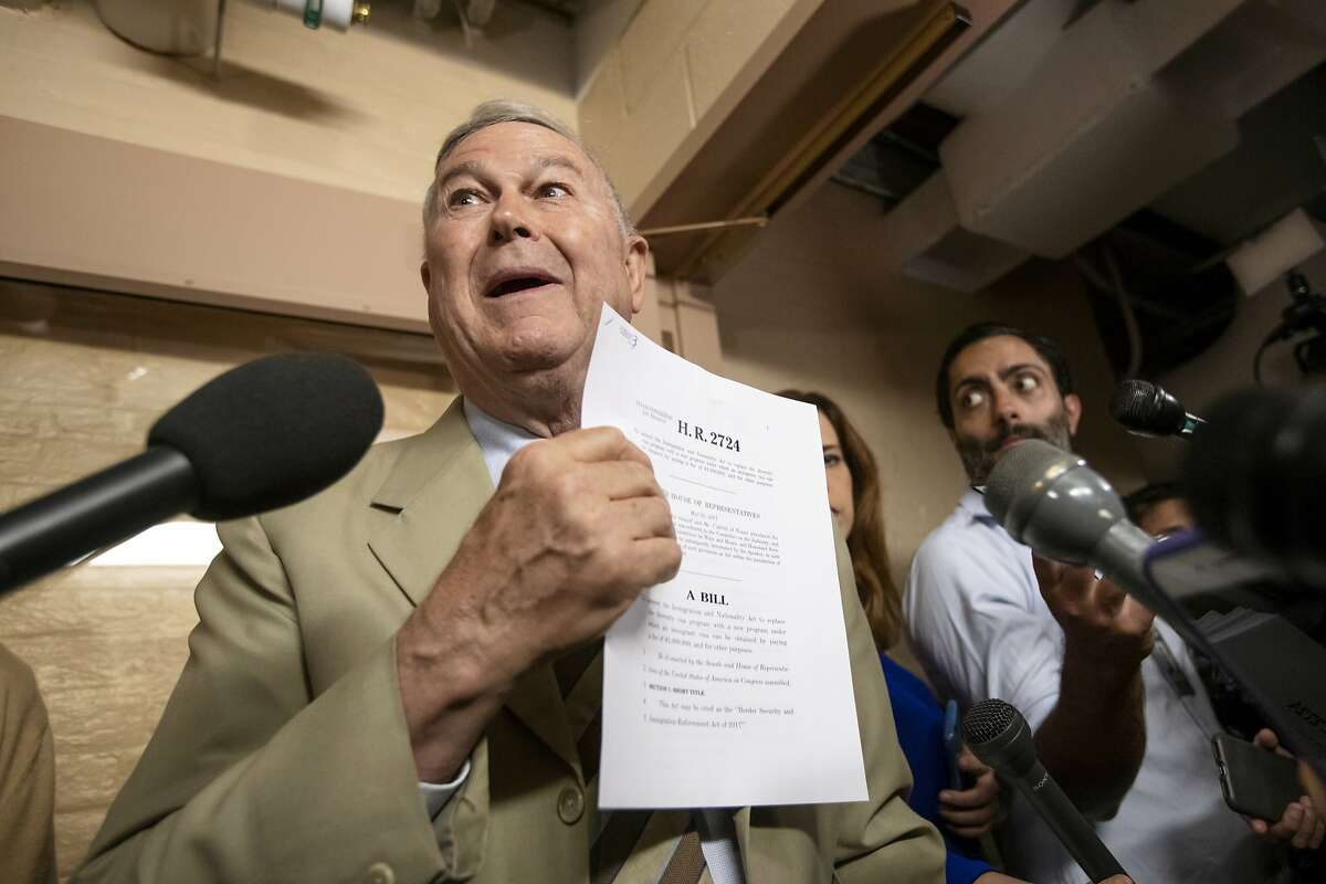 Rep. Dana Rohrabacher, R-Calif., speaks to reporters as he emerges from a closed-door meeting on Capitol Hill where House Republicans are trying to bridge their party's internal struggle over immigration in Washington, Thursday, June 7, 2018. Rohrabacher is holding an amendment he is introducing that proposes a $1 million fee for an immigrant visa. (AP Photo/J. Scott Applewhite)