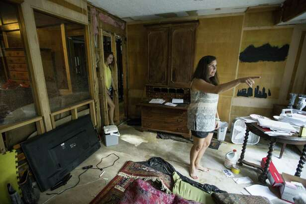 Aug. 25, 2018 is the deadline for flood insurance policyholders to submit a Proof of Loss to seek additional flood insurance payments for damage due to Hurricane Harvey. Pictured here: Clair Slaughter and her mother, Amy, stand inside their flood-damaged home as they rebuild, on Thursday, June 28, 2018, in Kingwood. The Slaughters are in favor of a project to dredge a large sandbar in the San Jacinto River, to help alleviate flooding in Kingwood. They are still recovering from the floodwaters from Hurricane Harvey, where they had 52 inches of water inside their home. ( Brett Coomer / Houston Chronicle )