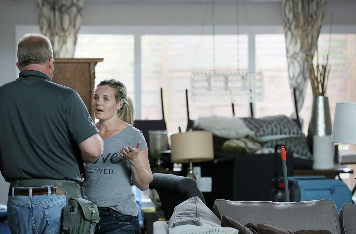 Aug. 25, 2018 is the deadline for flood insurance policyholders to submit a Proof of Loss to seek additional flood insurance payments for damage due to Hurricane Harvey. Pictured here: Erin Anders talks with an insurance adjuster in her flood-damaged Meyerland home Thursday, April 21, 2016, in Houston. The home has flooded twice in the last year, and Anders cannot afford to rebuild or raise the house. ( Jon Shapley / Houston Chronicle )