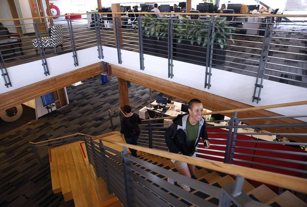 Employees climb a staircase between the second and third floors at the offices of Fastly in San Francisco, Calif. on Friday, July 20, 2018.