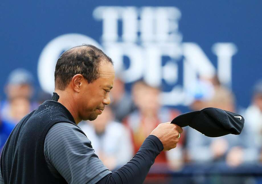 Tiger Woods acknowledges the crowd on the 18th green during the second round of the British Open. Woods carded a par-71 for the second day in a row. Photo: Sam Greenwood / Getty Images