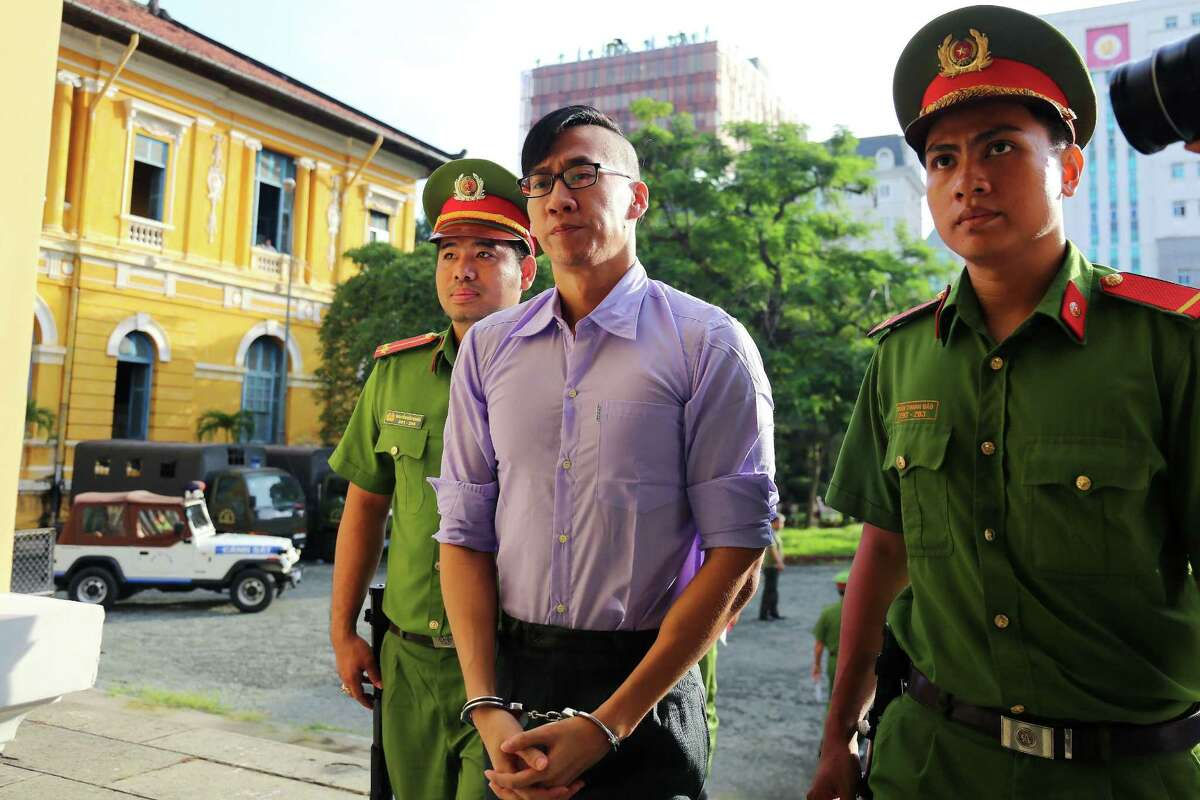 American-Vietnamese citizen William Nguyen is escorted by policemen to a courtroom for his trial in Ho Chi Minh City on July 20, 2018. He was convicted and released. AFP/Getty Images.