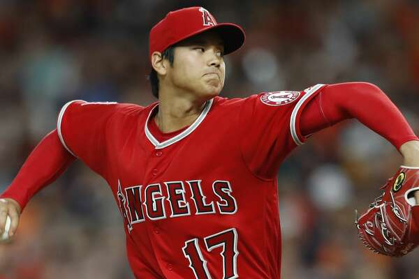 Los Angeles Angels starting pitcher Shohei Ohtani pitches during the fifth inning of an MLB game at Minute Maid Park, Tuesday, April 24, 2018, in Houston. ( Karen Warren  / Houston Chronicle )