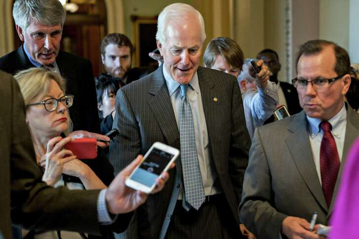 Senate Majority Whip John Cornyn, a Republican from Texas, speaks to members of the media at the U.S. Capitol in Washington, D.C., U.S., on Thursday, July 19, 2018. President Donald Trump disagrees with a Russian request to question U.S. officials including former Ambassador to Russia Michael McFaul, the White House said in a statement minutes before the Senate was expected to rebuke the president for considering the proposal. Photographer: Andrew Harrer/Bloomberg