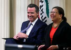 Lt. Gov. Gavin Newsom and State Controller Betty Yee wait for the arrival of Gov. Jerry Brown, who delivered the annual State of the State address at the State Capitol in Sacramento, Calif. on Thursday, Jan. 21, 2016.