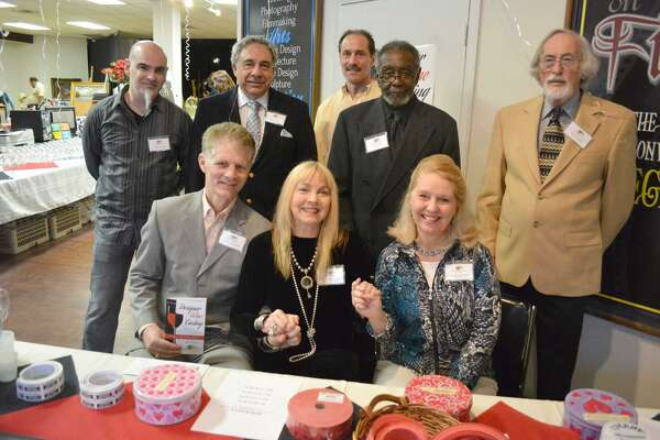 Bill Battle, fourth from the left in the back row, is seen with the rest of the CAFTA board of directors in 2014 during a fundraising event. Also pictured in the front row, from left, are CAFTA founders John Sullivan and Teresa Graham-Sullivan and Dierdre Houlihan DiCara.
