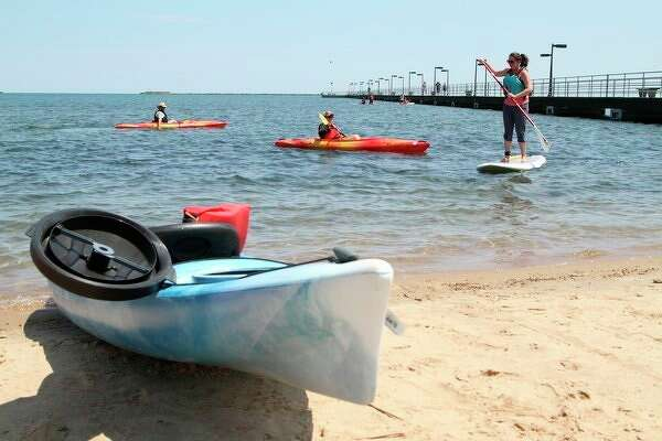 Hailey Pfaff is pictured on paddle board. (Coulter Mitchell/For the Tribune)