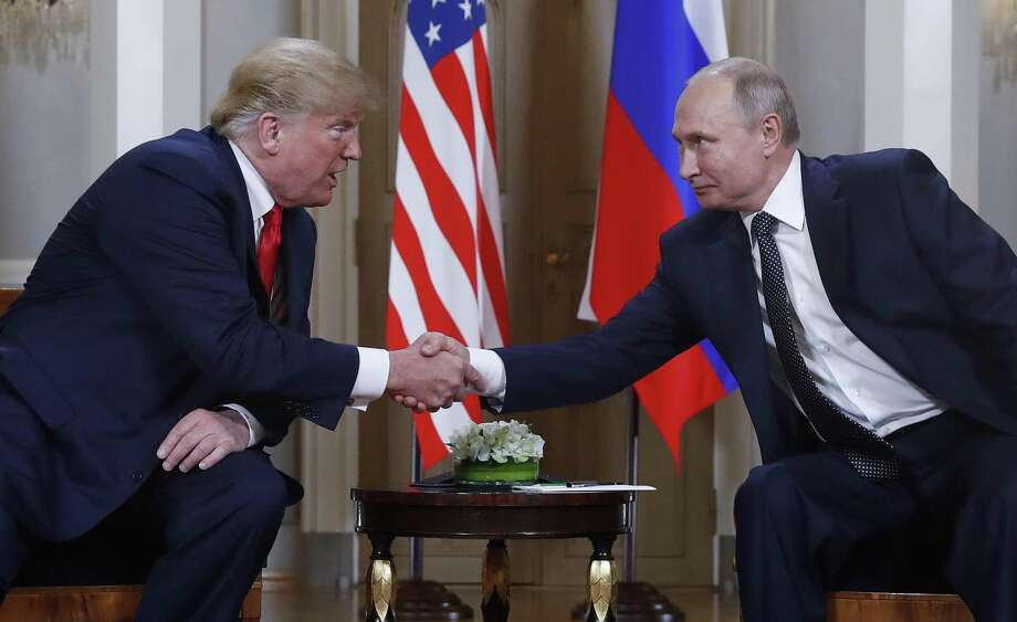 U.S. President Donald Trump, left, and Russian President Vladimir Putin, right, shake hand at the beginning of a meeting at the Presidential Palace in Helsinki, Finland, Monday, July 16, 2018. (AP Photo/Pablo Martinez Monsivais) Photo: Pablo Martinez Monsivais, STF / Associated Press / Copyright 2018 The Associated Press. All rights reserved