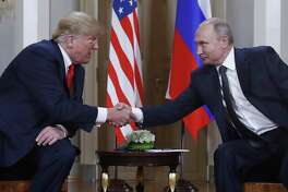 U.S. President Donald Trump, left, and Russian President Vladimir Putin, right, shake hand at the beginning of a meeting at the Presidential Palace in Helsinki, Finland, Monday, July 16, 2018. (AP Photo/Pablo Martinez Monsivais)