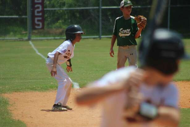 Damian Segura strays off third base, looking for a chance to score the team's seventh run during Friday's game against the Louisiana team. The team will be back in action Saturday morning at 9 as the Pony South Zone Tournament for the Bronco 11s comes down to the final two days.