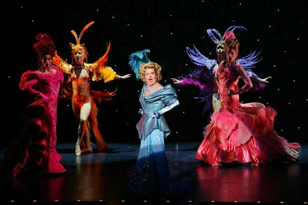 "FILE -- Gary Beach, center, in the musical ""La Cage Au Folles,"" at the Marquis Theater in New York, Dec. 3, 2004. Beach, a Tony Award-winning actor who could enliven a stage whether wearing a lavish gown, dressed as King Arthur or decked out as a candelabra, died on July 17, 2018 at his home in Palm Springs, Calif. He was 70. (Sara Krulwich/The New York Times)"