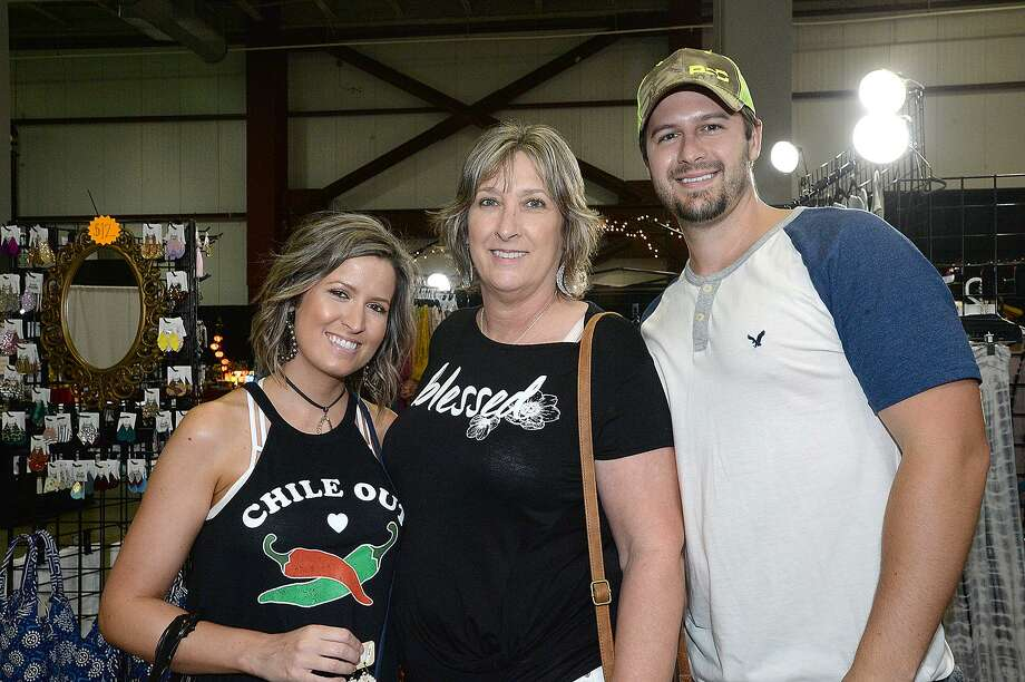 """Lindsey, Lisa and Dustin Batson were at the Peddler Show and SETX Great Outdoors Expo dual shopping show running throughout the weekend at Ford Park. The """"His and Hers Weekend"""" event features designers, artists,craftsmen, fashion, beauty, home goods and outdoor equipment and recreation. The tiger show is also back, with the addition of a baby tigers petting station.  Friday, July 20, 2018  Kim Brent/The Enterprise Photo: Kim Brent / The Enterprise / BEN"""