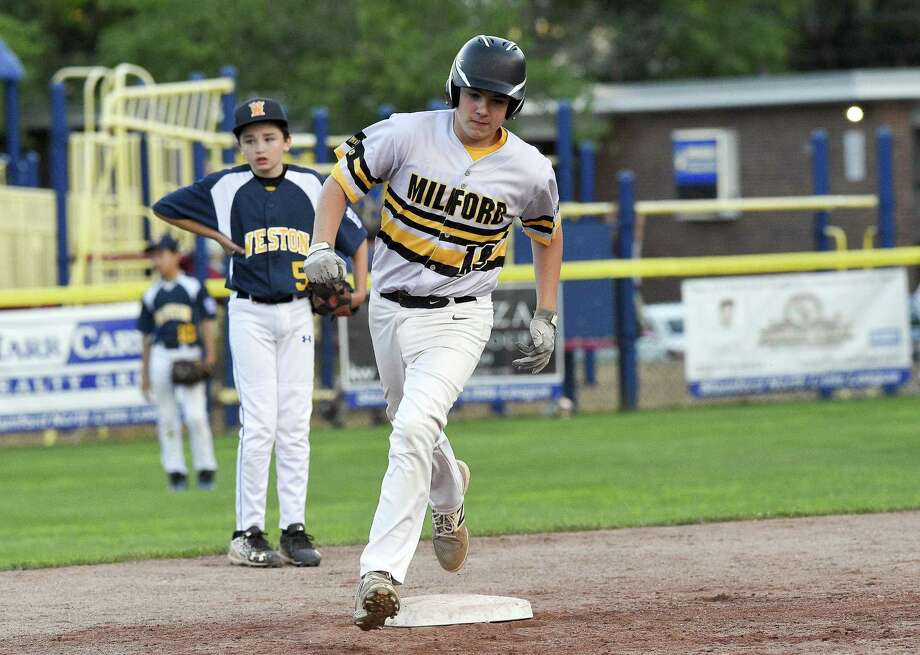 Milford's Zach Worzel rounds the bases after hitting a game winning homerun in the fifth inning against Weston in a Section 1 Little League baseball tournament at Drotar Park on July 20, 2018 in Stamford, Connecticut. Milford won 5-4. Photo: Matthew Brown / Hearst Connecticut Media / Stamford Advocate