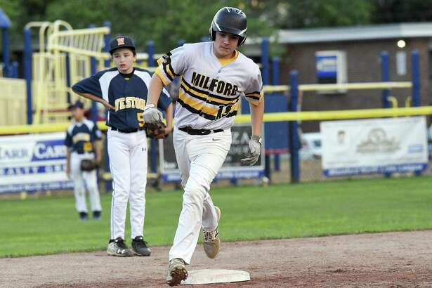 Milford's Zach Worzel rounds the bases after hitting a game winning homerun in the fifth inning against Weston in a Section 1 Little League baseball tournament at Drotar Park on July 20, 2018 in Stamford, Connecticut. Milford won 5-4.