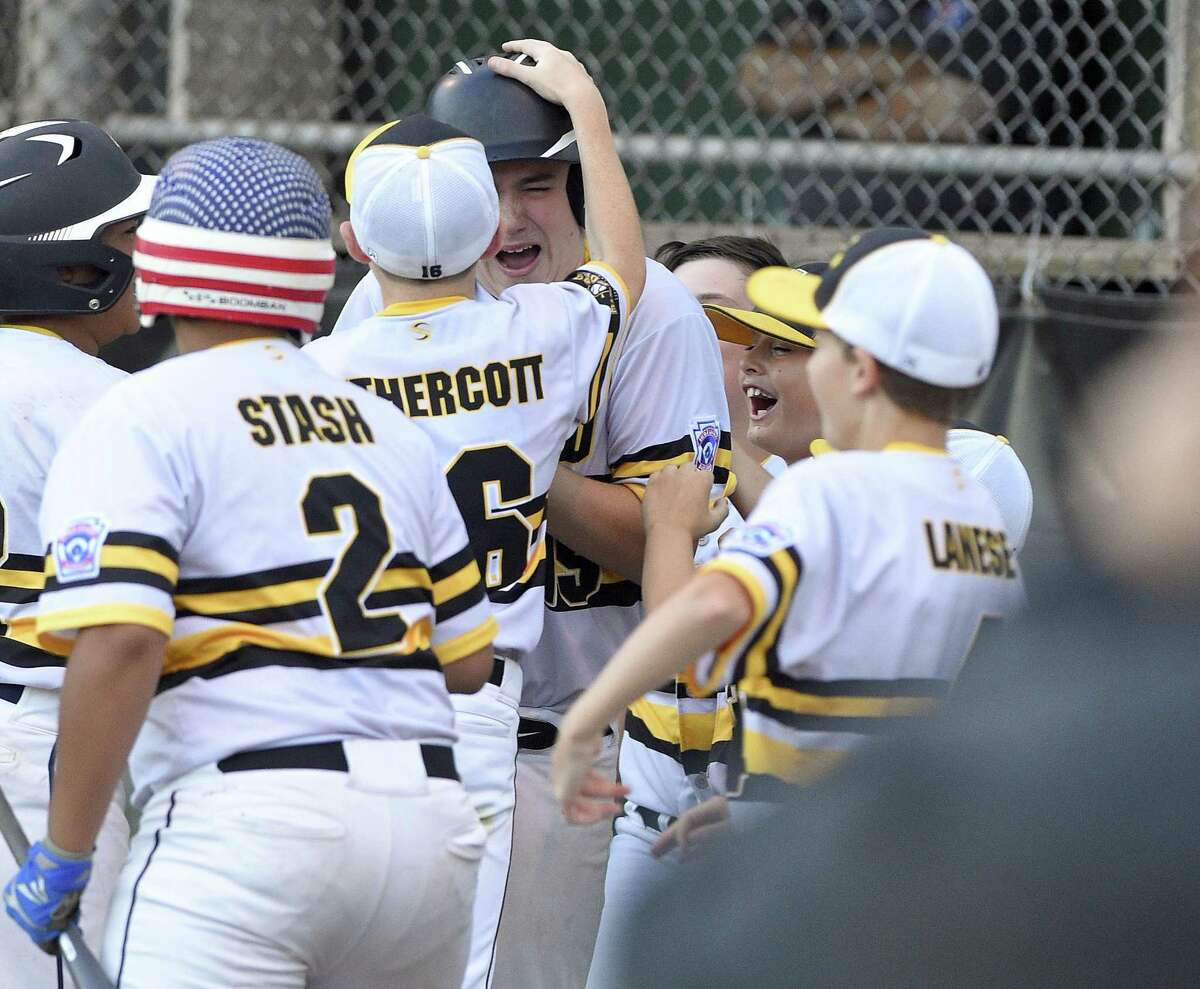 Milford's Zach Worzel celebrates with his teammates after hitting a game winning homerun in the fifth inning against Weston in a Section 1 Little League baseball tournament at Drotar Park on July 20, 2018 in Stamford, Connecticut. Milford won 5-4.
