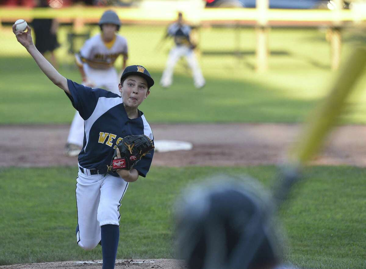 Weston pitcher Aiden Forrest (2) makes his delivery against Milford in the first inning in a Section 1 Little League baseball tournament at Drotar Park on July 20, 2018 in Stamford, Connecticut. Milford won 5-4.